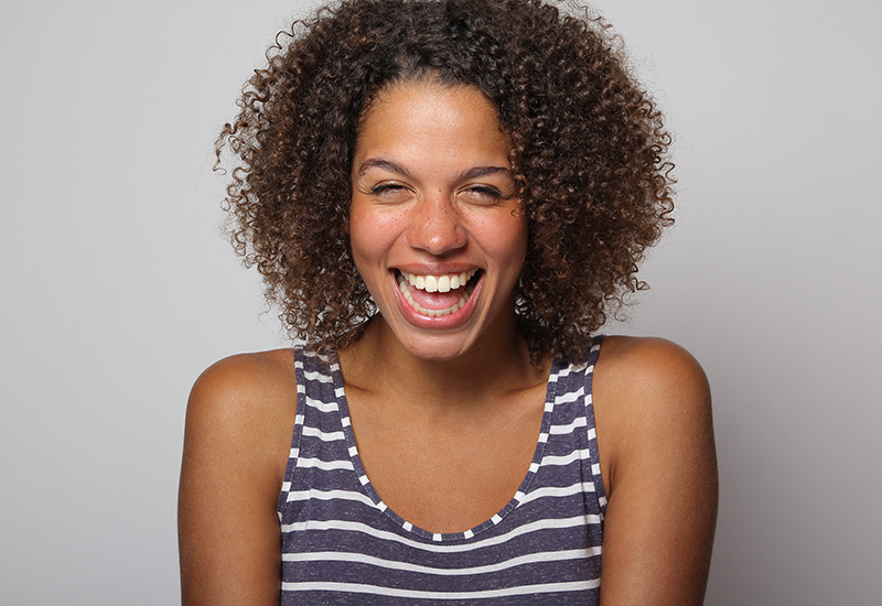 Curly hair woman in blue and white striped tanktop